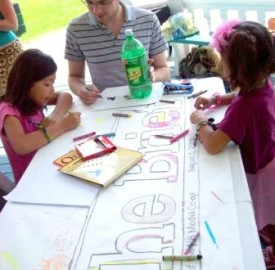 Colouring at Fredericton Peace Coalition's Family Fun Day