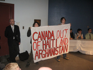 Fredericton university students protest former Canadian Prime Minister Paul Martin's talk at the University of New Brunswick in 2007.