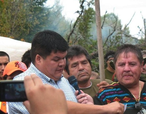 """Elsipogtog Chief Aaron Sock announcing the resumption of indigenous control over """"Crown lands."""" He also served SWN Resources with a 24 hour eviction notice to leave his territory. Photo by Dallas MacQuarrie."""