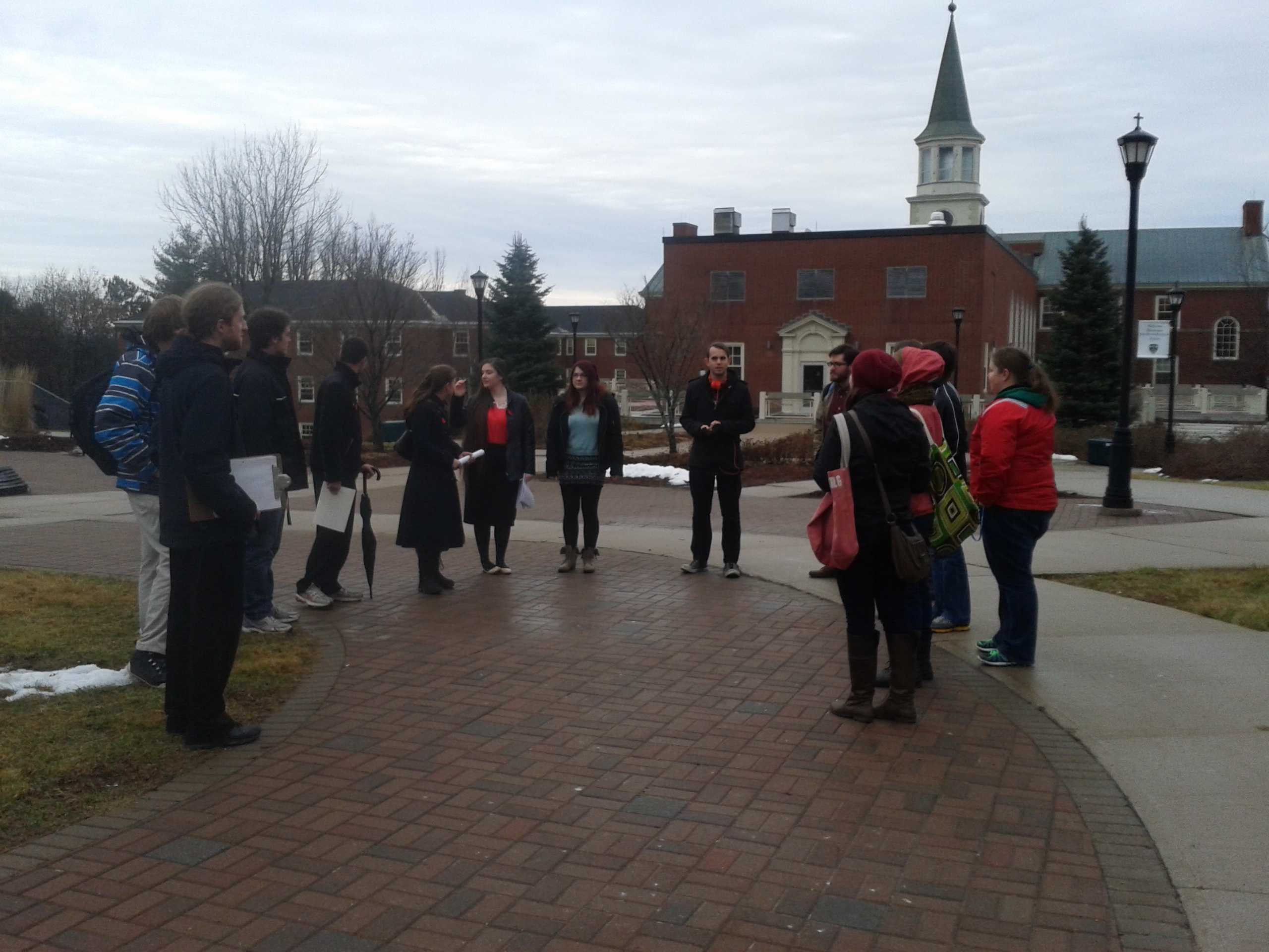 Red T movement members gather before delivering letter