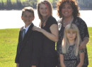 The Simoneau children; from left to right: James, 14, Shania, 17, Kendra, 10, with their mother Annie.