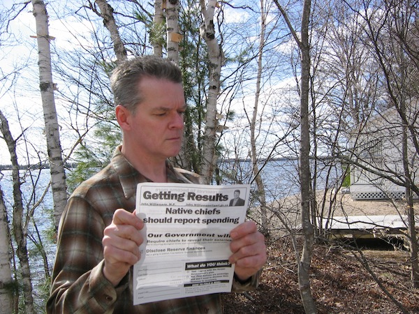 Terry Wishart examining the flyer from MP John Williamson at his home in Harvey. Photo courtesy of Terry Wishart.