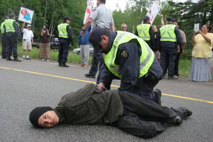 Segewaat, who has been tending the sacred fire for over a week, was among the first to be arrested at the shale gas protest site along Route 126 in New Brunswick on June 21st. Photo by M. Howe.