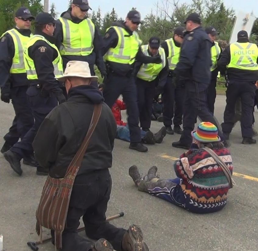 Susan and Dallas McQuarrie being arrested at the shale gas protest site on Route 126 in June. Photo by Caroline Lubbe-D'Arcy.