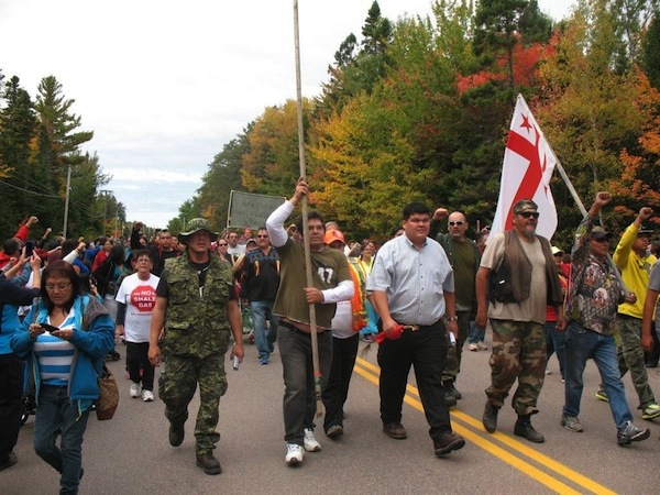 Elsipogtog Chief Arren Sock accompanied by indigenous warriors and members of his community as he entered the anti-shale gas blockade in Rexton on Oct. 1st, 2013. Photo by Dallas MacQuarrie.